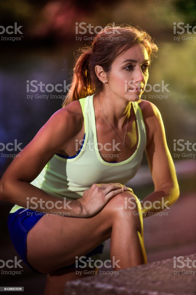 Fit Female Runner Stretching Prior to Workout stock photo