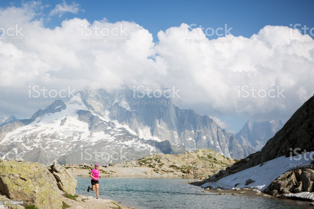 Fit female running in the mountains stock photo