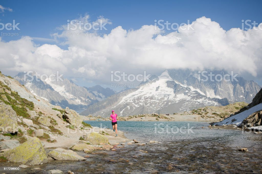 Fit female running near the lake stock photo