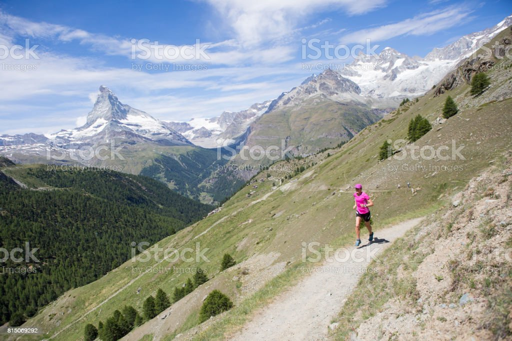 Fit female running outdoors stock photo