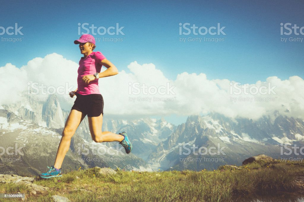 Fit female running stock photo