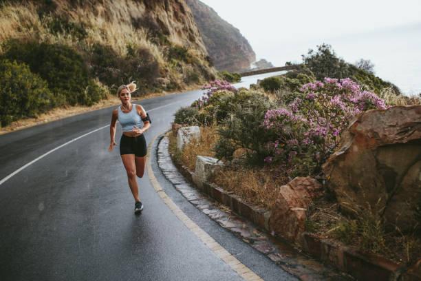 fit female training outdoor in beautiful landscape - jogging hill bildbanksfoton och bilder