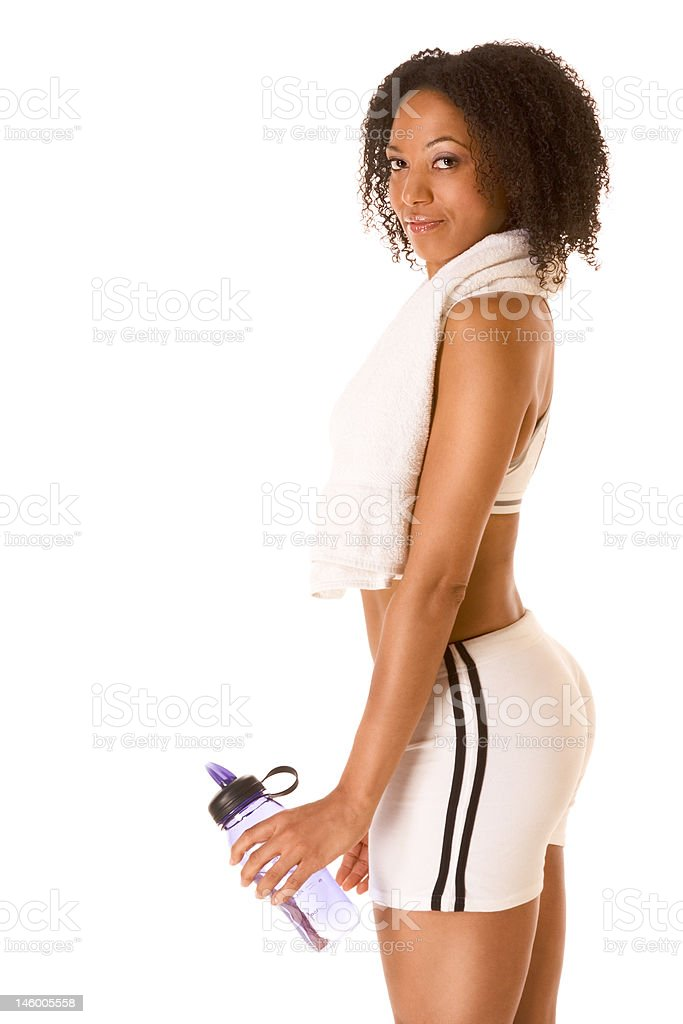 Fit female with bottle of water and towel royalty-free stock photo