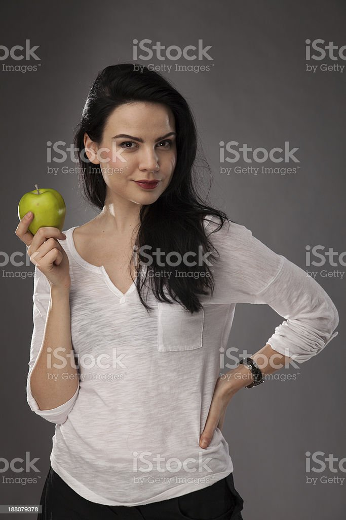 Fit girl holding apple stock photo