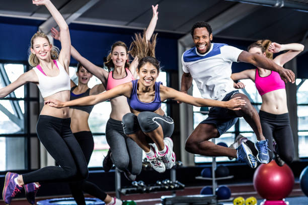 Fit group smiling and jumping stock photo