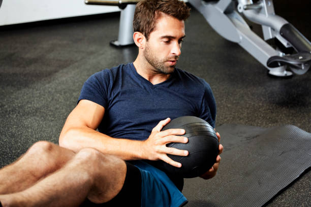 fit guy in gym - sit ups stock photos and pictures