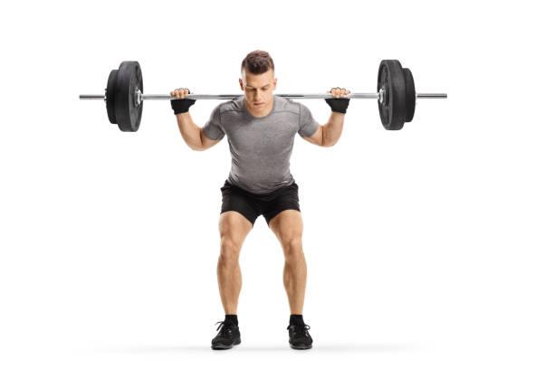 fit guy lifting weights - pesistica foto e immagini stock
