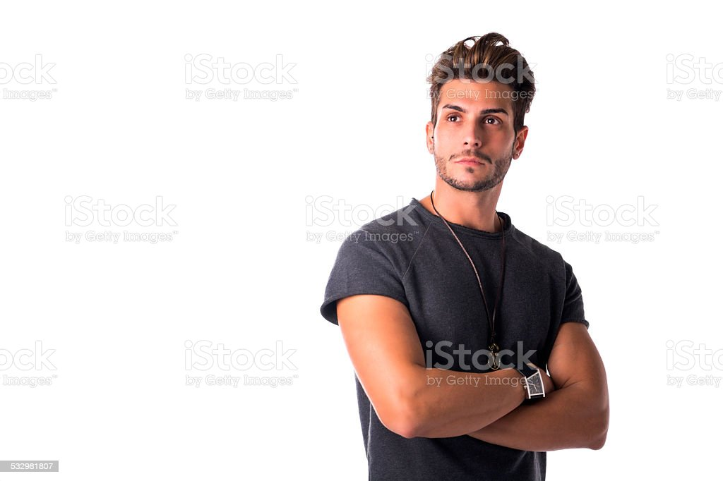 Fit handsome young man confident with arms crossed, looking up stock photo