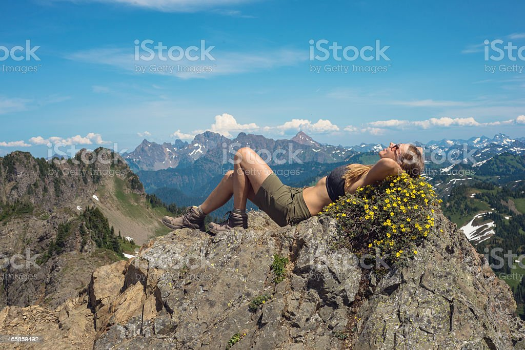 Fit Hiker Relaxing at Summit stock photo