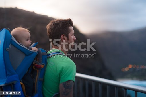 Looking out at a high view after a long hike. Family being active together
