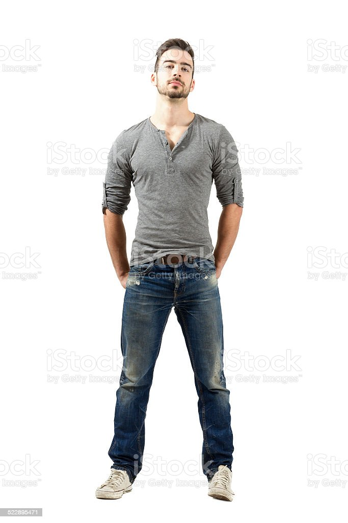 Fit male fashion model posing with hands in back pockets stock photo