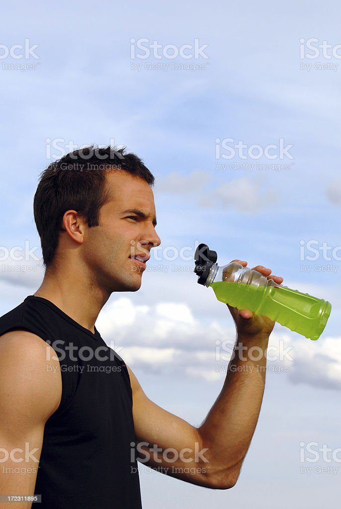 Fit man and sports drink Vertical royalty-free stock photo