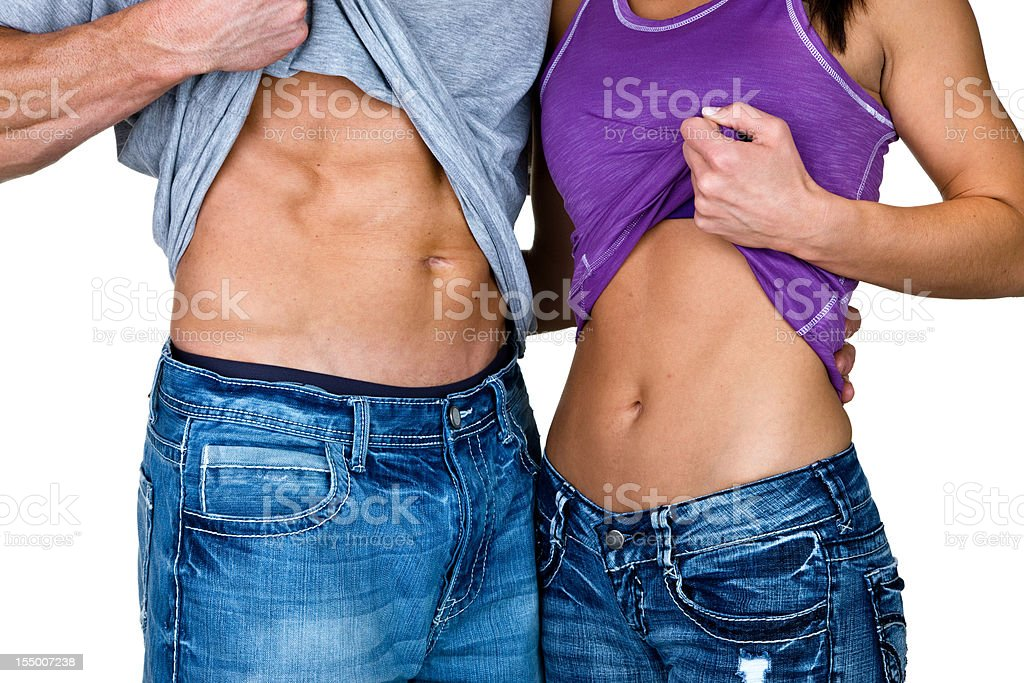 Fit man and woman showing  pack abs royalty-free stock photo