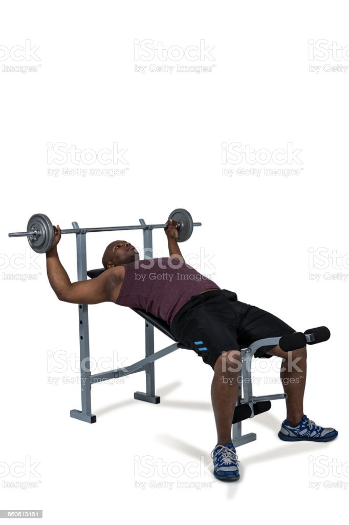 Fit man exercising with barbell royalty-free stock photo