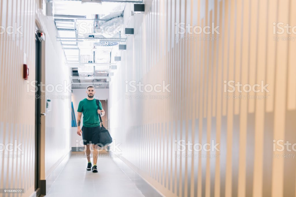 Fit man in a gym corridor. stock photo