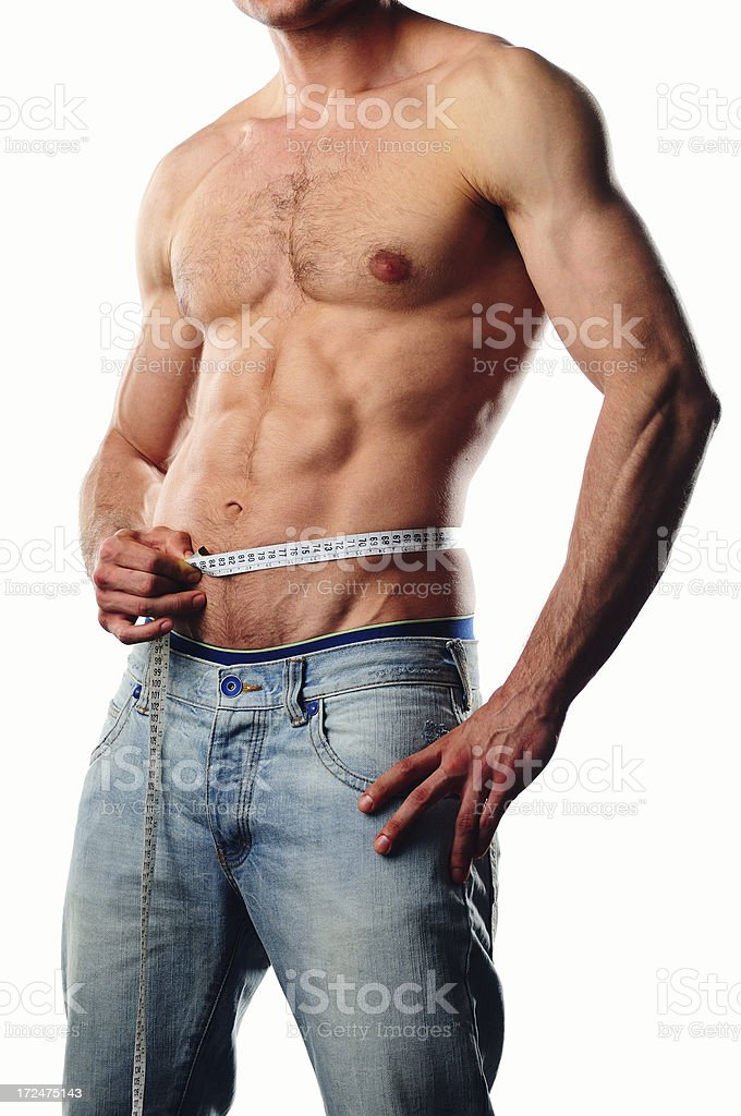 Fit man measuring his waist royalty-free stock photo