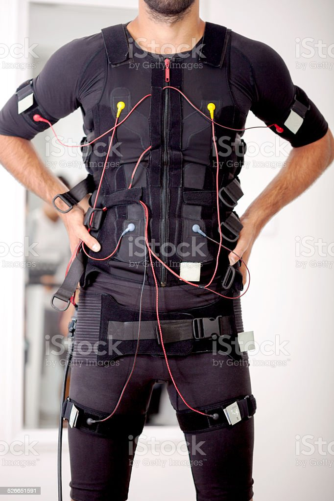 fit man on  electro muscular stimulation machine stock photo