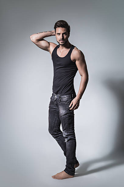 Fit man posing in jeans and shirt stock photo