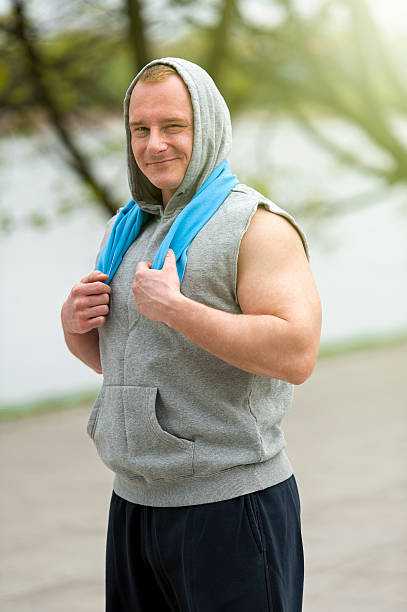 Fit man resting after jogging. stock photo
