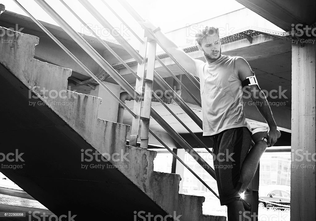 fit man streching before working out stock photo