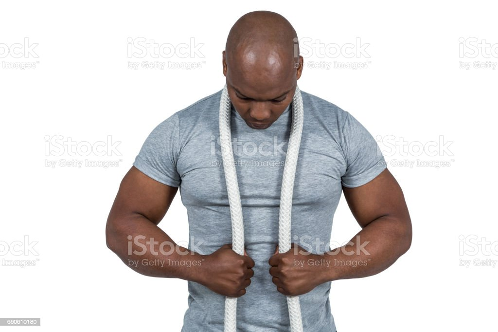 Fit man with battle rope royalty-free stock photo