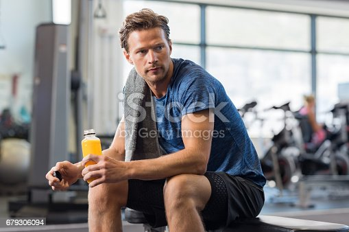istock Fit man with energy drink 679306094