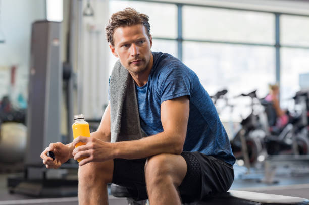 Fit man with energy drink stock photo