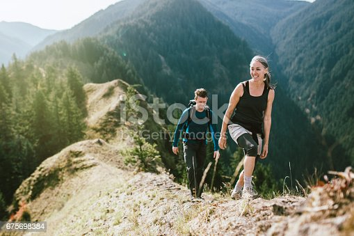 istock Fit Mature Couple on Mountain Hike 675698384