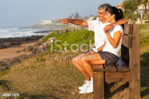 452783143 istock photo fit middle aged husband and wife at beach 465617379