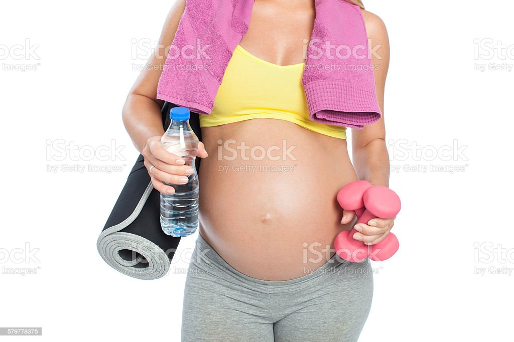 Fit mother to be stock photo