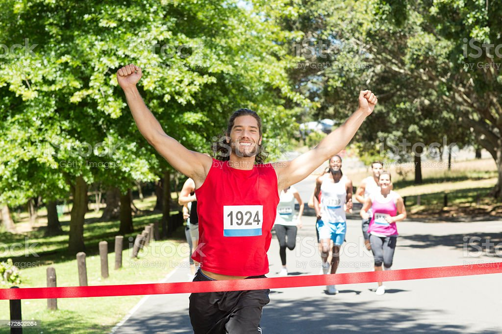 Fit people running race in park stock photo