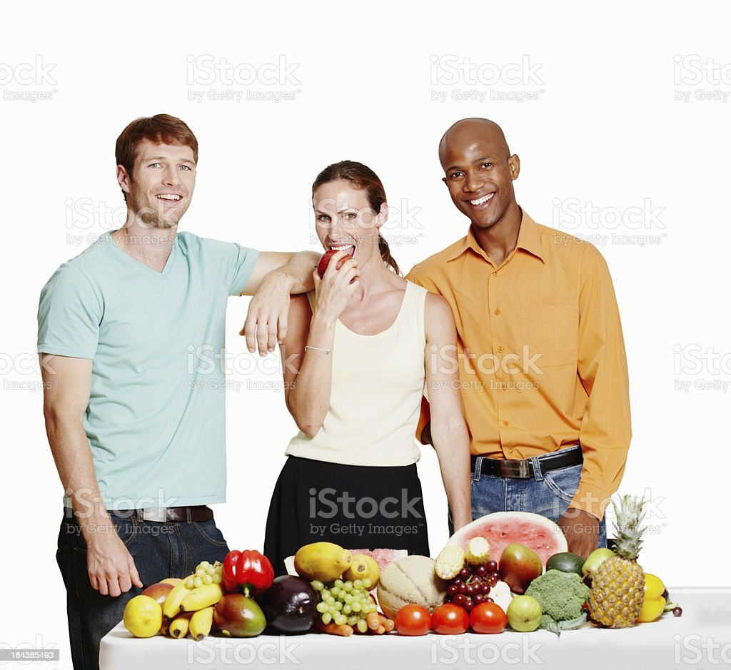 Fit people with table of vegetables royalty-free stock photo