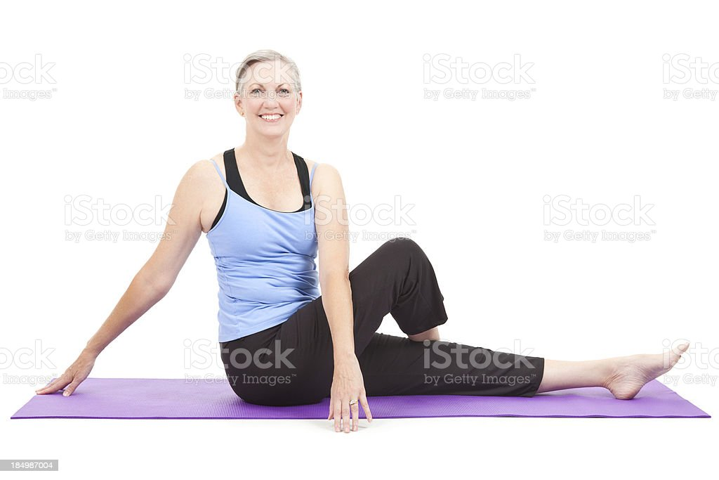 Fit senior adult woman stretching on an exercise mat royalty-free stock photo