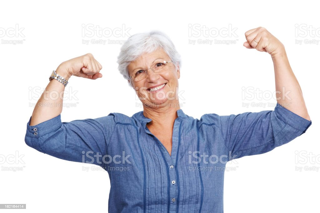 Fit senior female showing her biceps stock photo