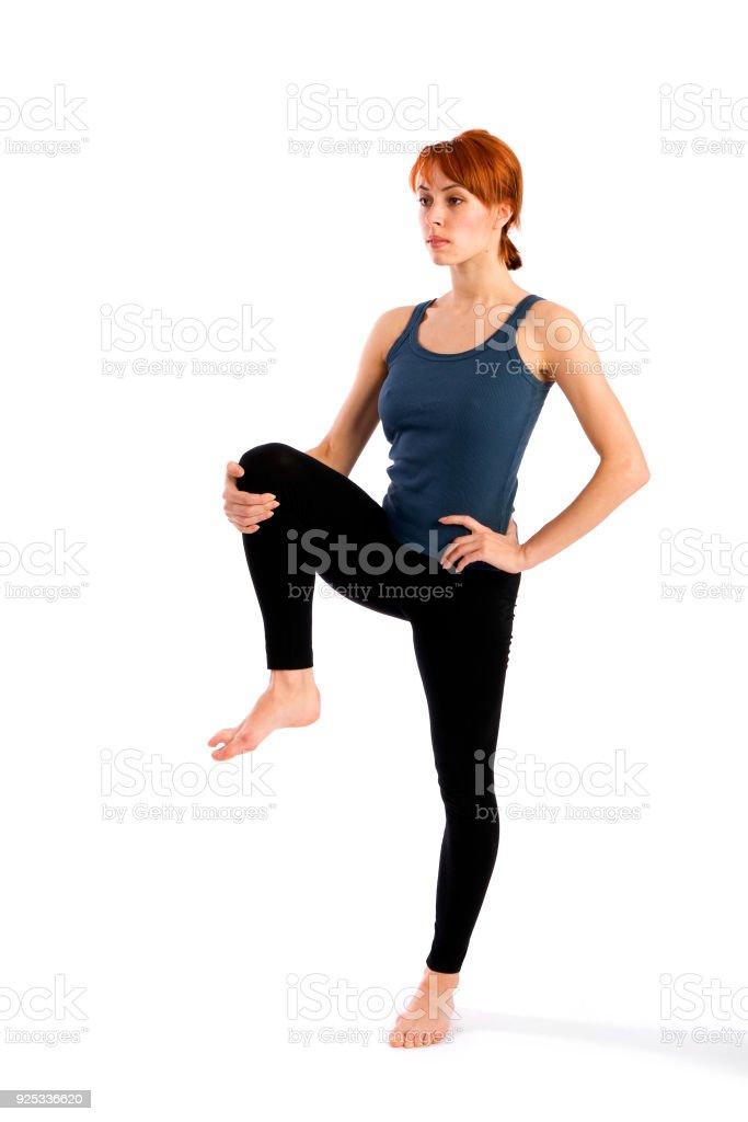 Fit Slim Woman Practicing Yoga stock photo