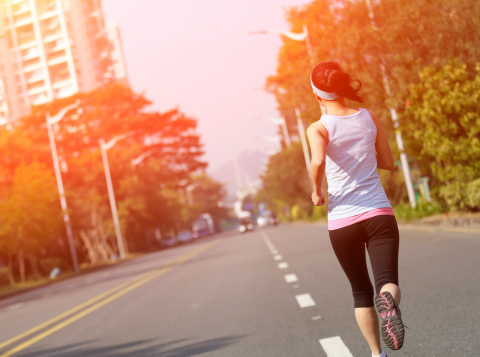 Fit Sports Woman Running At Asphalt Road Stock Photo - Download Image Now