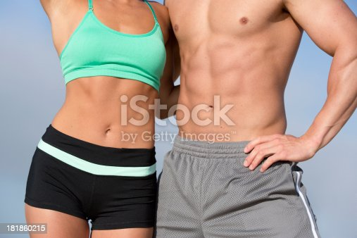 waist shot of fit man and woman in sports wear as fitness concept