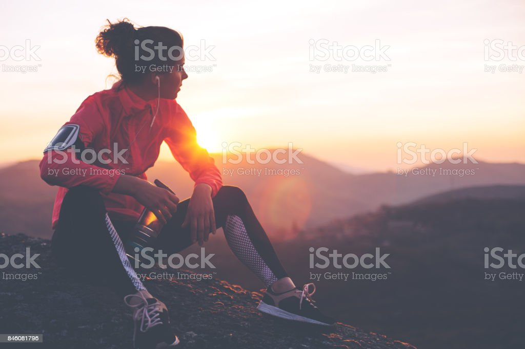 Fit woman athlete resting outdoors stock photo