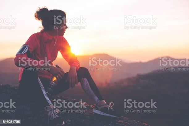 Photo of Fit woman athlete resting outdoors
