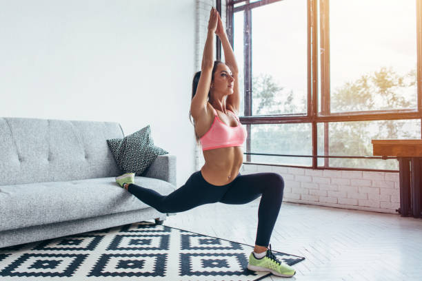 Fit woman doing front forward one leg step lunge exercises workout Fit woman doing front forward one leg step lunge exercises workout. hamstring stock pictures, royalty-free photos & images