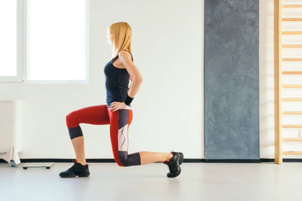 fit woman doing lunges - lunge stock photos and pictures