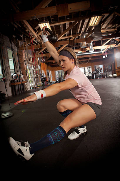 Fit woman doing one legged squats. stock photo