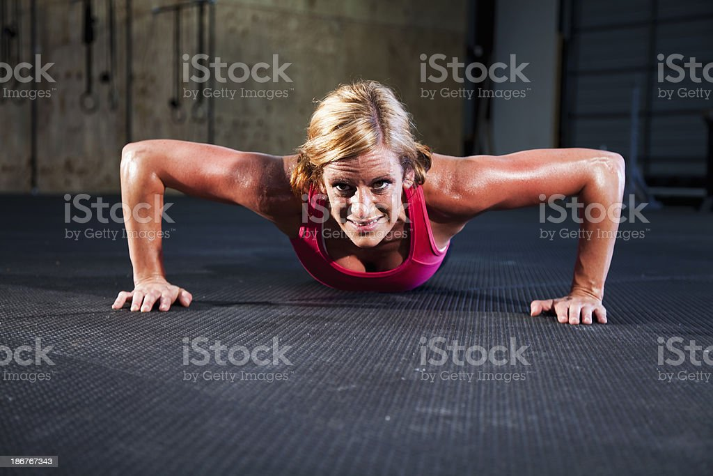 Fit woman doing push-ups stock photo