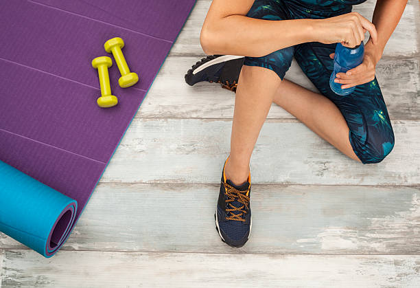 Fit woman doing sports at home stock photo