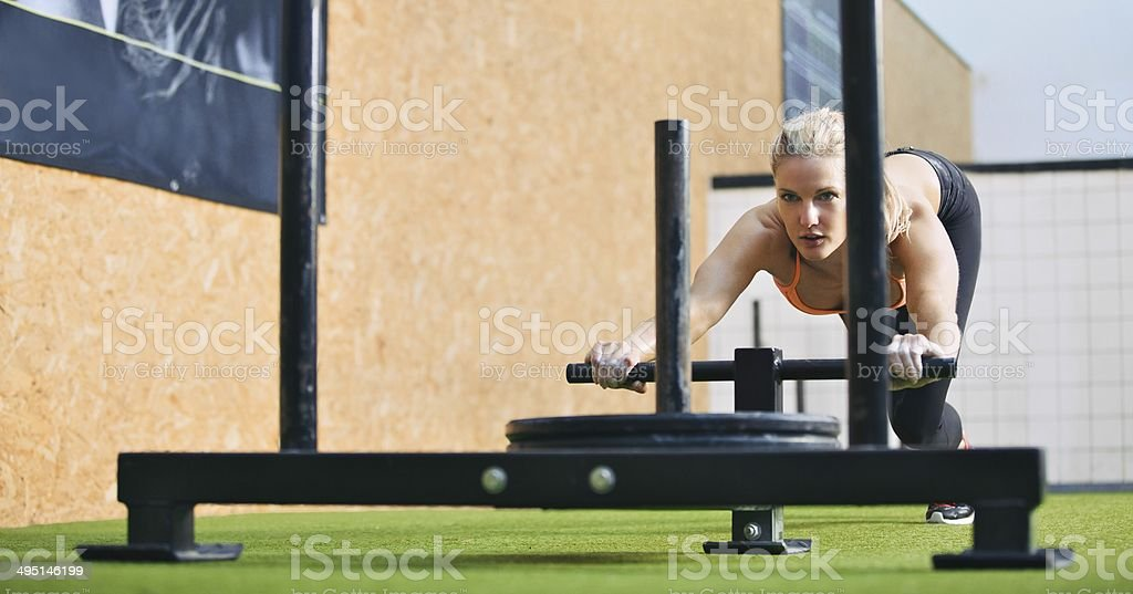 Fit woman exercising to stay stock photo