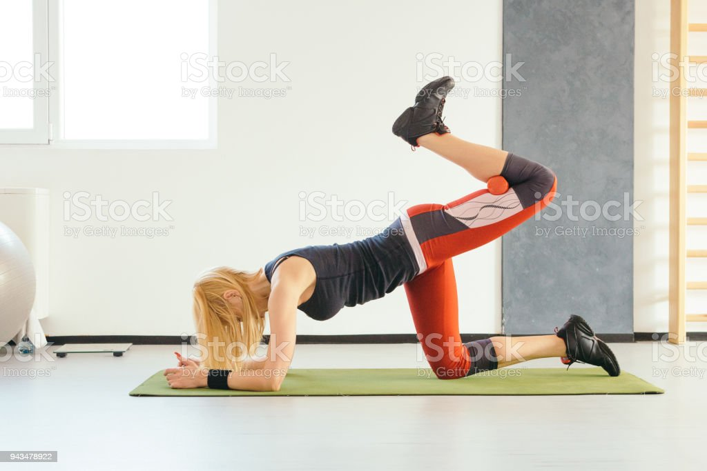 Fit Woman Glute Exercise in the Table Top Position stock photo