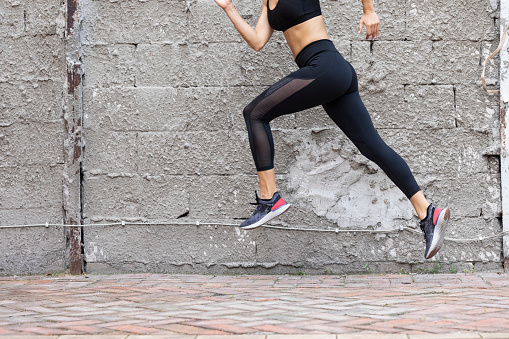 Active lifestyle: a fit woman runner during her morning running workout.