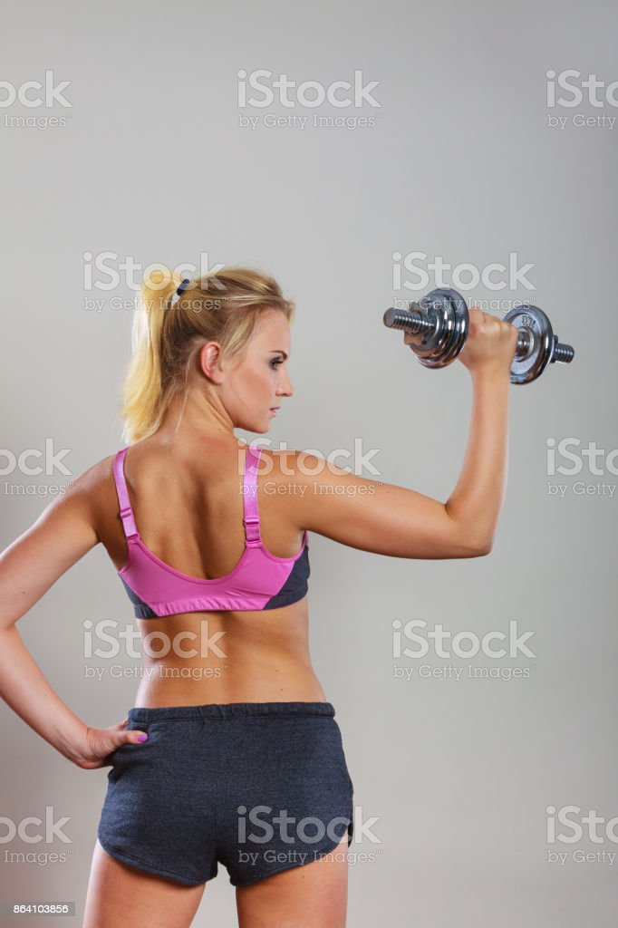 Fit woman lifting dumbbells weights royalty-free stock photo