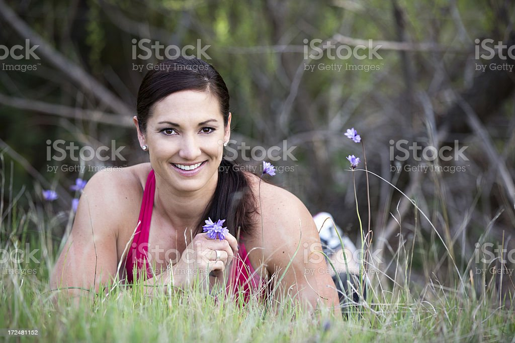 Fit Woman Lying In Spring Grass royalty-free stock photo