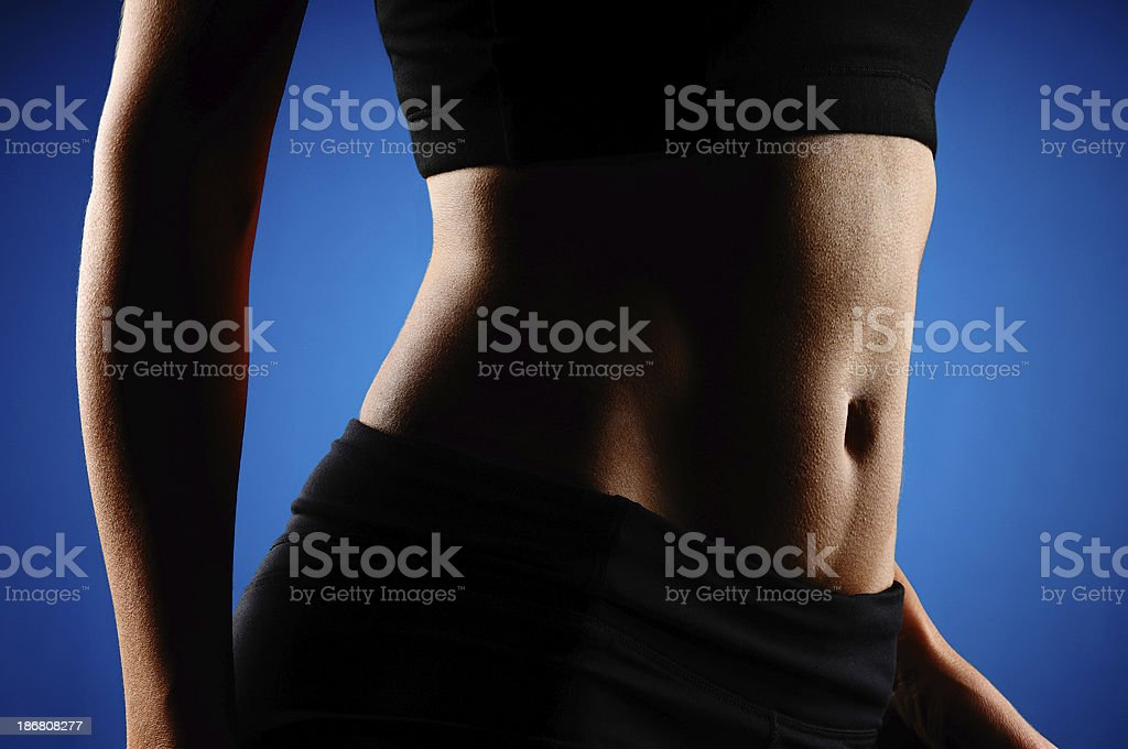Fit Woman on Blue Background royalty-free stock photo